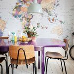 Maps make great murals, as shown in this bright, casual dining space.