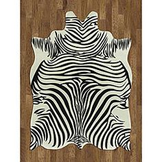 @Overstock - Zebra Hide Polyproplene Rug (5' x 7') - Make your home more fun with this novelty zebra rug. This white rug features black zebra stripes, so you can add a quirky accent to your room without going overboard. This indoor area rug is durable, with a thickness of a real animal skin hide.    http://www.overstock.com/Home-Garden/Zebra-Hide-Polyproplene-Rug-5-x-7/3977356/product.html?CID=214117  $86.99