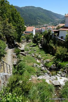 Why the Serra da Estrela is the Star of Central Portugal - by Julie Dawn Fox 16.08.2014 | The muted clanging of sheep and goat bells drifts up from the valley to where I'm standing. Coupled with the pure mountain air and magnificent views of rocky ridges and distant plains, it's idyllic indeed. So lovely that I'm kicking myself for putting off exploring the Serra da Estrela for so long. Photo: Path along the village stream in Manteigas, Serra da Estrela