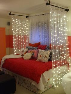A screen of lighted sheer fabric surrounding your bed.