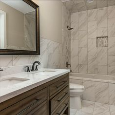 These bathrooms are cohesive and modern and complement the modern design throughout this custom home. We love the natural color tones, floor to ceiling tile and modern vanities. Listed for $1,350,000 in Oakton, VA by The Casey Samson Team is a Wall Street Journal Top Team in Northern Virginia.