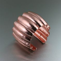 Ribbed #Fold #Formed #Copper #Cuff - You'll love the big, bold look of this ribbed Fold Formed Copper Cuff. It is substantial enough to stand alone, and also lovely layered with other favorite copper pieces. It definitely is the accessorizing answer your everyday outfits need. $170 http://www.ilovecopperjewelry.com/ribbed-fold-formed-copper-cuff.html