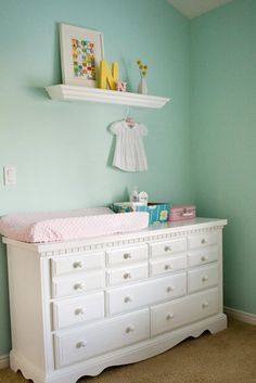 All white painted dresser - maybe you could start watching for a cute shaped one on Kijiji and then paint it and use it as a changing table too!