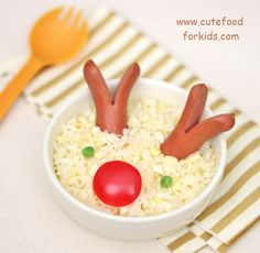 """This """"Rudolph in a bowl"""" was made from turkey dog, fried rice, peas and red pepper. Tips: - Cut the hot dog before cook it - If you don't know how to make fried rice, please check """"this post"""" for recipe. - You may use mashed potato or mac and cheese instead of rice - Serve it on a plate would work too!"""