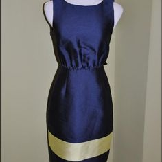 J. Crew Collection Silk dress Navy pencil dress with a bold chartreuse stripe along the bottom. Awesome low v back detailing with bow like tie up in the back. Size 4 j. Crew collection still has tags and never worn. Retails do $358 J. Crew Dresses