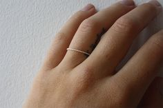 Organically manufactured thin recycled sterling silver ring hand made in Gothenburg Sweden.