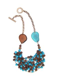 Jasperstones along with turquoise imitation beads crotchet together creating a cluster necklace. It is accented by ...