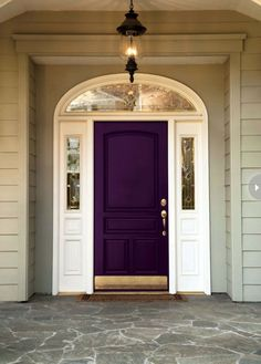 Not sure I'd be brave enough to do this but I love this purple door!