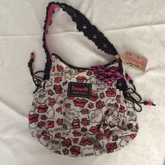 Authentic Betsey Johnson Handbag Authentic Betsey Johnson handbag. This is a used item with normal wear and tear. See pictures. Betsey Johnson Bags