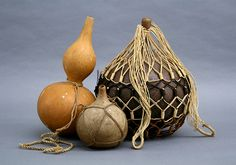 S. M.  Damon Collection Hue wai with koko (gourd water containers with carriers) Gourd, olona and sennit cordage  19th century, Hawaiian Islands From the S.M. Damon Collection, Bishop Museum ( B.02671-3)  This image is exclusively for publicity purposes.  Permission for any other use of this material must be sought separately.