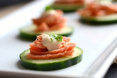 Low-Fat Appetizers For New Year's Eve - Sun-dried tomato pesto crostinis, Goat cheese-stuffed mushroom caps, Salmon-topped cucumber bites