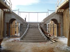 Here is a picture of a stone staircase under construction. Our stone staircases can be custom designed to fit any space. Click on the picture to view more photos. #Stone #Staircase #Design #Home #Design