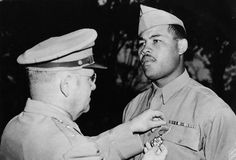Boxing legend Joe Louis enlisted in the Army in and entered a segregated unit. Rather than deploying the famous athlete, the Army used him to raise morale by having him put on performances and attend media events. African American Men, American History, Joe Louis, Sports Stars, Army & Navy, Black History Month, Second World, Black Is Beautiful, Armed Forces