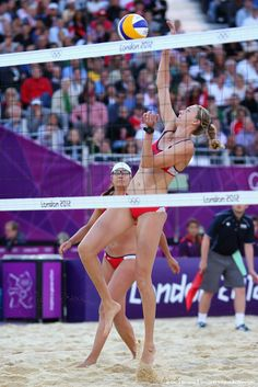 Image detail for -Kerri Walsh Jennings (R) and Misty May-Treanor of the U.S. celebrate a point against Italy's Greta Cicolari and Marta Menegatti during their women's quarterfinals beach volleyball match at Horse Guards