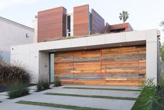 A unique and modern garage door made from new and reclaimed wood.
