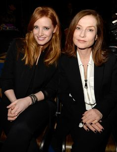 (L-R) Jessica Chastain and Isabelle Huppert attend the Givenchy show as part of the Paris Fashion Week Womenswear Fall/Winter 2015/2016 on March 8, 2015 in Paris, France.