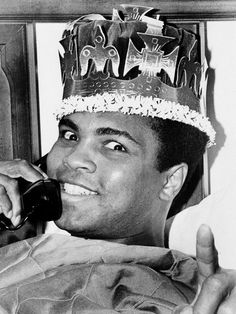Muhammad Ali, in a jovial mood as his March 8 bout with Joe Frazier draws near, is seen speaking on the phone and wearing a kings crown, March 6, 1971, in Miami Beach.