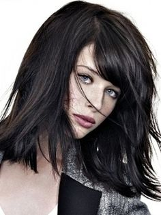 Shoulder-length layered hairstyle. . . Dark brown hair.