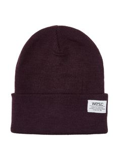"WeSC Plum Perfect Puncho Beanie PRODUCT DETAILS  Beanie Front logo detail Allover knit design Not lined Material: 100% Acrylic Approx. measurements: length 9"", width 8"" Care: Hand wash cold Origin: Imported"