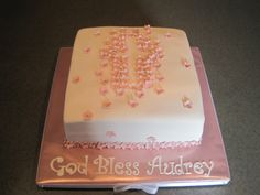 """Pink Baptism Cake - 10"""" square WASC with raspberry buttercream for a girl's baptism. Cross formed with small flowers"""