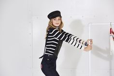 Welcome to the new nautical: the TOMMYXGIGI collection is a playful update of seafaring classics. Add nautical flair to your look with this navy blue cap  --with Gigi Hadid --
