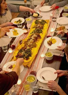 This week I've been sharing one of the most fun dinner parties I've ever hosted — we invited six friends over and threw an Italian polenta party anchored by a four-foot-long board in the middle of the table! Today I want to share the whole party with you and show you how it all came together. From dramatic polenta pouring, to bottles of red wine, to my favorite tip for keeping polenta warm and creamy for hours before dinner, here's a peek inside this cozy supper.