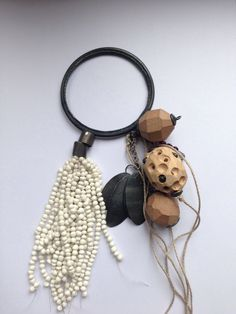 Brooch Chequita Nahar, silver, porcelain, wood,