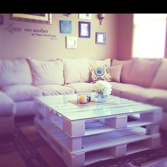 My pallet table with glass on top! Makes it look a little classy. :)