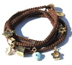 Charm Wrap Bracelet with 24 Gold Plated Good Luck Charms -- Startling review available here  : Jewelry