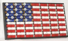 """This American flag was handcrafted using 91 authentic """"spent,"""" red, white and blue, 12 gauge shotgun shell hulls with an additional 21"""