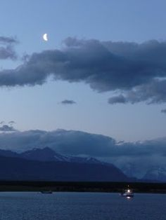 Moon and Boat on the Chilean Fjords, Puerto Natales, Chile (photo by Luis Bastardo)
