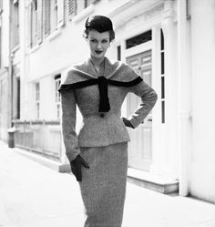 Massey Suit: May 27, 1954: A woman modelling a tailored Simon Massey suit with a short cape and a nipped waistline. (Photo by Chaloner Woods/Getty Images) #1950s #Fashion