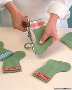These stockings are just large enough to hold a small gift or sweet for each of the 24 days of Advent. If your tree is too small to hold 24 stockings, hang the rest from a ribbon swag.Use a computer to print numbers, then cut them out and glue them to metal-rimmed tags; or label the tags by hand. Use felt in various colors, and add ribbons in complementary hues.If you like, hang a swag of stockings without tags across the mantel, tie them onto gifts, or hang them from the tree.