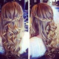 Curly hair with a braid on each side.