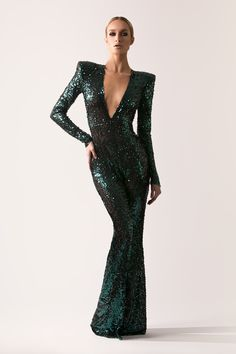 Structured low plunge squin jumpsuit with flared leg, strong shoulder & closed back.- Michael Costello US Size Chart- Terms / Conditions- Shipping- Made to order- Include inches of heels when selecting height- Dry clean only- Thinking about custom measurements? Ask us about custom options custom@shopcostello.com