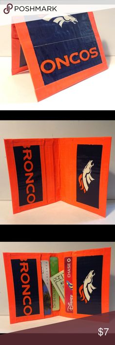 """4-Pocket Card Cash Wallet Denver Broncos Denver Broncos Print 4-pocket Credit Card Wallet Folded Measurement: 3"""" x 4"""" Handcrafted from quality DuckBrand Duck Tape, all side seams are handsewn for a lasting product, inside of pockets are clear-coated to prevent sticking. Available in all NFL, MLB and most Collegiate teams upon request. Duck Duct Bloom Bags Wallets"""