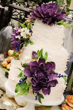 The Mischief Maker|Sugar ruffle-frill wedding cake with purple sugar flowers and sugar berries #mischiefmakercakes