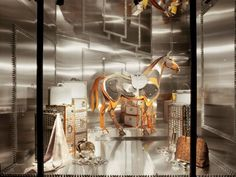 One of the best window displays featuring a horse, IMHO, is the display pictured below ~ Hermes' Window Design Director Leïla Menchari's Spring 2011 window display in the Hermes flagship Paris store
