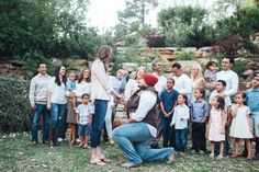 He asked her to marry him during a family photo. <3