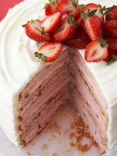 6 Layer Strawberry Cake - Keep the strawberries coming with this sweet and moist six-layer cake. Add 2 tablespoons of strawberry liqueur for additional fruit flavor, and sprinkle on coconut flakes and white chocolate curls for extra eye appeal.