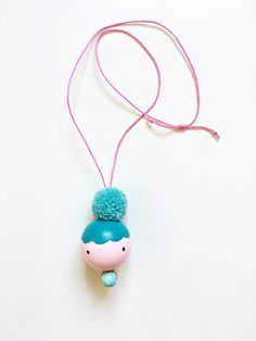 Handmade Doll Face & Pom Pom Statement Necklace for Kids. The perfect statement jewelry for littles. Diy Jewelry Rings, Jewelery, Handmade Jewelry, Wood Peg Dolls, Clothespin Dolls, Bead Crafts, Jewelry Crafts, Polymer Beads, Pom Pom Crafts