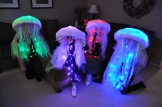 Jellyfish costumes.  Made these for our 4 kids.  Used LED lights, sombreros, bubble wrap, lace for tentacles and lots of tulle everywhere.