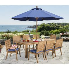 This 9-piece dining set includes a table and 8 chairs. Each piece is crafted from solid plantation grown teak that's durable and weather-resistant with mortise and tenon construction. The teak ages to a weathered silvery patina over time or you can apply teak sealer (not included) to maintain the golden brown color of new teak. Rust-resistant brass hardware completes the elegant and functional design.   Product