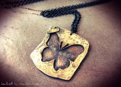 Hey, I found this really awesome Etsy listing at http://www.etsy.com/listing/161759740/butterfly-necklace-copper-and-pewter