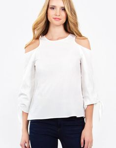– Cold shoulder tie sleeve top – Button closure on back – Color: Off White  Size + Fit – Model is wearing size S – Measurements taken from size S – Length: 24.75″ – Chest: 37.5″
