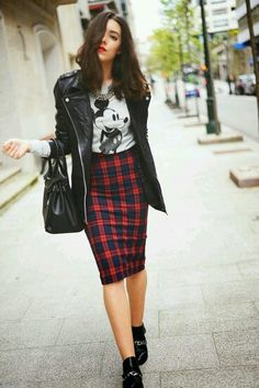 Leather jacket, pencil skirt, funky necklace, and quirky tee.