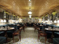 gorgeous patterned floor and blue velvet banquettes, Little House Mayfair