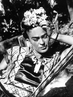 Frida Kahlo - After her marriage to Diego Rivera, Frida Kahlo, who had once favored men's clothes, incorporated elements of traditional Mexican dress into her wardrobe, topping full skirts and embroidered tops with braided, beribboned, and flower topped hair styles that sometimes gave her the aspect of a religious icon.