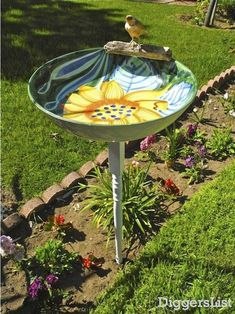 A serving bowl and table leg repurposed into a colorful bird bath!