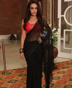 Bollywood black saree with red blouse/Indian saree The Effective Pictures We Offer You About bow Blouse A quality picture can tell you many things. You can find the most beautiful pictures that can be Indian Blouse, Indian Sarees, Indian Wear, Saree Blouse Patterns, Saree Blouse Designs, Red Dress Outfit, Dress Outfits, Indian Dresses, Indian Outfits